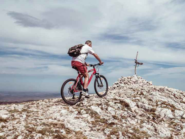 man riding bicycle on off road