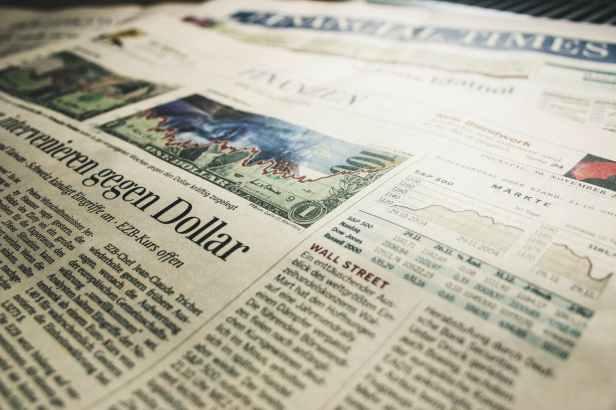 finance dollars newspaper stock