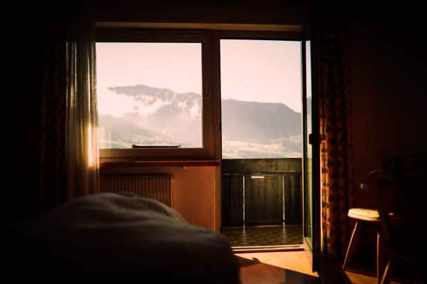 a room with view of mountains