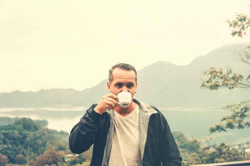 man drinking outdoors