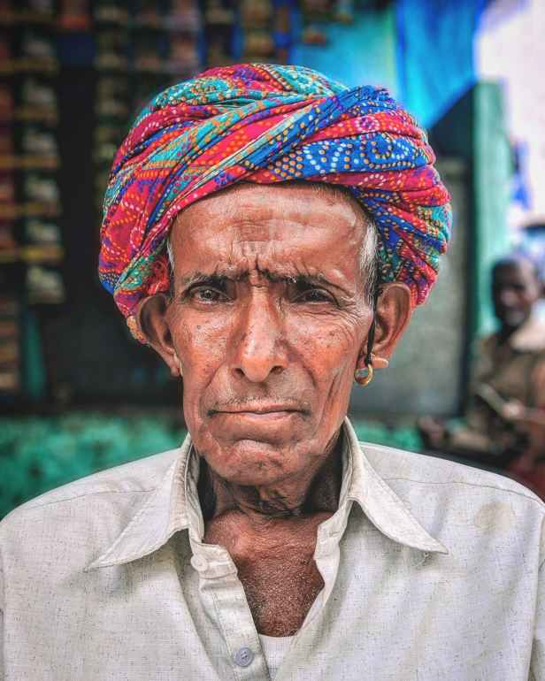 portrait photography of an old man wearing headscarf