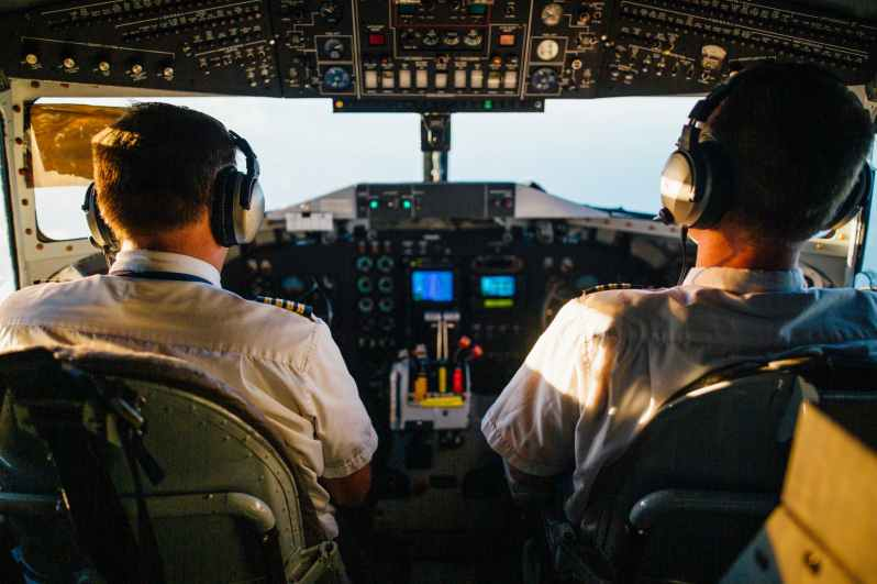 two pilots flying an airplane