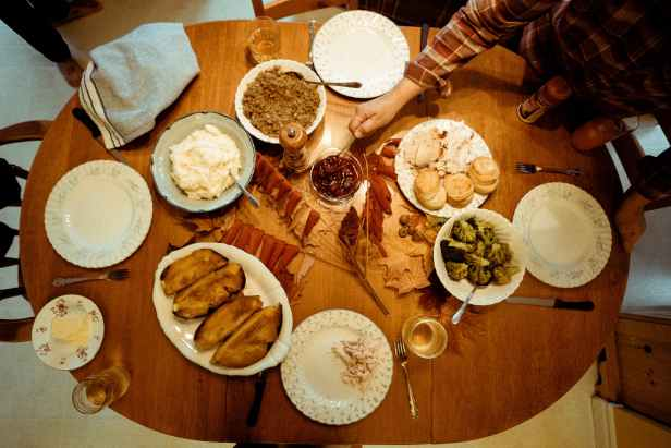 flatlay photography of cooked food on brown wooden table