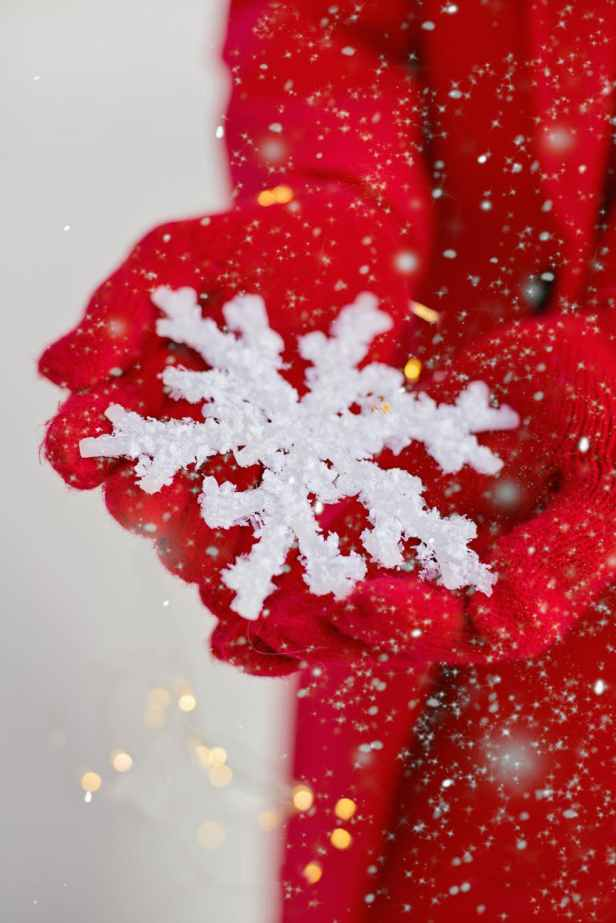 person holding a snowflake