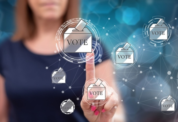 Woman touching an online voting concept